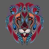 Patterned colored head of the lion. African / indian / totem / tattoo design. It may be used for design of a t-shirt, bag, postcar Stock Image