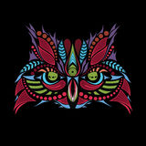 Patterned colored head of the owl on black. African / indian / totem / tattoo design Royalty Free Stock Image