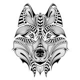Patterned colored head of the wolf. Royalty Free Stock Images