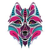 Patterned colored head of the wolf. African / indian / totem / tattoo design Royalty Free Stock Photography