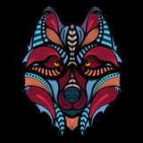 Patterned colored head of the wolf. African / indian / totem / tattoo design Stock Image