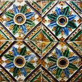 Patterned colored tiles on houses symbol of Lisbon. Abstract, ornament, European authentic style.  Stock Photos