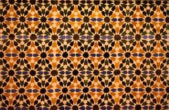 Patterned coloured tiles at the Alhambra, Granada, Spain. Royalty Free Stock Images