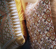 Patterned cosy cushions. Abstract background of cosy cushions with decorative floral patterns Stock Image