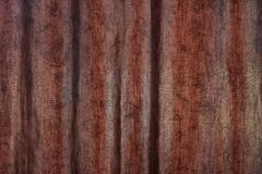 Patterned creasy fabric textile curtain surface texture. High quality, brown patterned creasy fabric textile surface texture in good condition stock photos