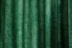 Patterned creasy fabric textile curtain surface texture. High quality, green patterned creasy fabric textile surface texture in good condition royalty free stock photo