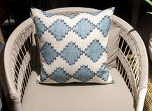Patterned Cushion on Wicker Chair. Stylish and Bold Patterned Cushion on Elegant Rattan Chair stock photography