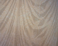 Patterned draped beige background Stock Photos