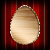 Patterned Easter egg in golden frame Royalty Free Stock Photography
