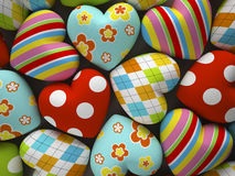Patterned fabric hearts on dark background Royalty Free Stock Photos