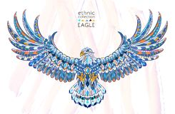 Patterned flying blue eagle on watercolor background. Patterned flying eagle on the watercolor background. It may be used for design of a t-shirt, bag, postcard Stock Photo