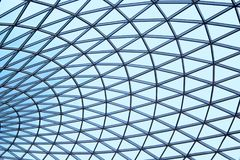 Patterned Glass Ceiling. Blue glass and steel geometric ceiling royalty free stock photos