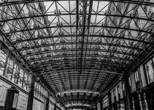 Modern architecture detail, steel and glass ceiling, black and white. Patterned glass ceiling covers gallery between older buildings stock images
