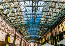 Modern architecture detail, steel and glass ceiling. Patterned glass ceiling covers gallery between older buildings royalty free stock images