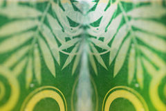 Patterned glass of water with green leaves attached. Royalty Free Stock Photo