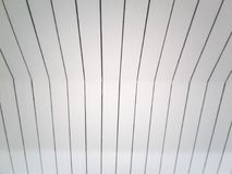 Straight lines from the ceiling. Patterned for gray and abstract backgrounds royalty free stock images