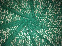 Patterned green lace fabric Stock Image