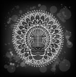 Patterned head of the lion on the grunge background. African indian totem tattoo design. Royalty Free Stock Photo