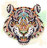 Patterned head of the roaring tiger. On the grunge background. African, indian, totem, tattoo design. It may be used for design of a t-shirt, bag, postcard, a royalty free illustration