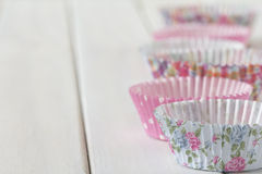 Patterned Muffin Cups in a Line on Table Stock Images