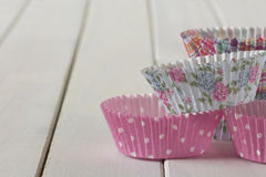 Patterned Muffin Cups Stacked on Table Royalty Free Stock Photo