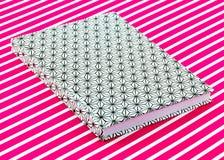 Patterned notebook on striped background Stock Photo
