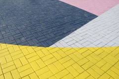 Patterned paving tiles. Cement brick floor background Stock Photos