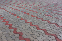 Patterned paving tiles, cement brick floor background Royalty Free Stock Photography