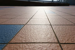 patterned paving tiles, cement brick floor background and sunlight Royalty Free Stock Images