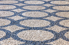 Patterned paving tiles in Lisbon city, Portugal. Black and white patterned paving tiles in Lisbon city, Portugal royalty free stock image