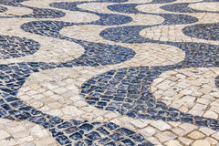 Patterned paving tiles in Lisbon city, Portugal Stock Images