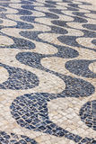 Patterned paving tiles in Lisbon city, Portugal Stock Image