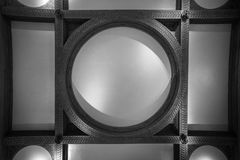 Patterned raised ceiling. Raised ceiling, circular design surrounding by rectangles stock photos