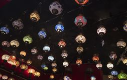 Patterned regional lamps hanged on the wall stock photography