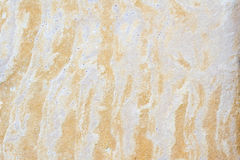 Patterned sandstone texture background. Royalty Free Stock Images