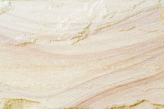 Patterned sandstone texture background. Natural color Royalty Free Stock Image