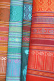 Patterned silk fabrics from Thailand. Multicoloured patterned silk fabrics in a row from Thailand Stock Photography