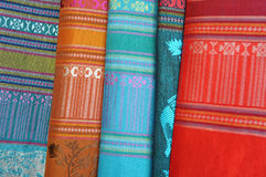 Patterned silk fabrics from Thailand. Multicoloured patterned silk fabrics in a row from Thailand royalty free stock photography
