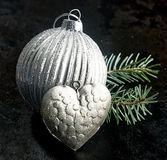 Patterned silver Christmas bauble and heart Royalty Free Stock Image