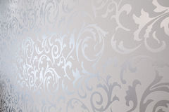 Patterned silver wallpaper Stock Photo