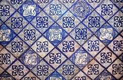 Patterned spanish design of old house tile. Historical walls decoration in Spain. Country stock images