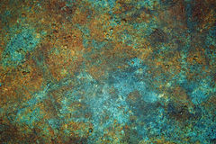 Patterned Stone Texture. Multicolored stone texture with copper highlights and embedded micro-fossils Stock Photos