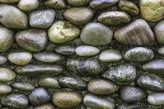 Patterned surface of the stone wall. Stock Photo