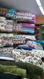 Patterned textile. Rolls of patterned textile lying in shop Royalty Free Stock Photography
