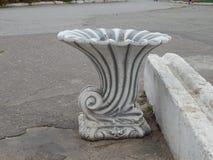 Patterned urn. Beautiful plaster urn Stock Photo