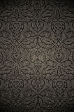 Patterned wallpaper. Dark stylish old-fashioned wallpaper with an ornate pattern Royalty Free Stock Photo