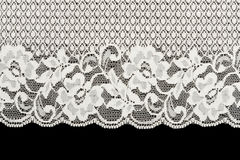 Patterned white lace on black background Royalty Free Stock Image