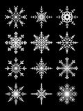 Patterned white snowflakes Royalty Free Stock Photos