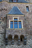 Patterned window on  stone wall of  medieval castle. Royalty Free Stock Photography