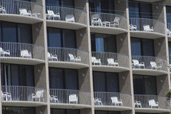 Patterned Windows. And balconies on urban structure Royalty Free Stock Image